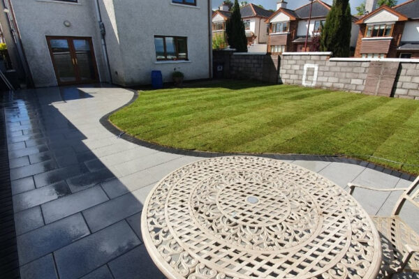 Beautiful Patio Transformation with Turf Lawn and New Walls in Togher