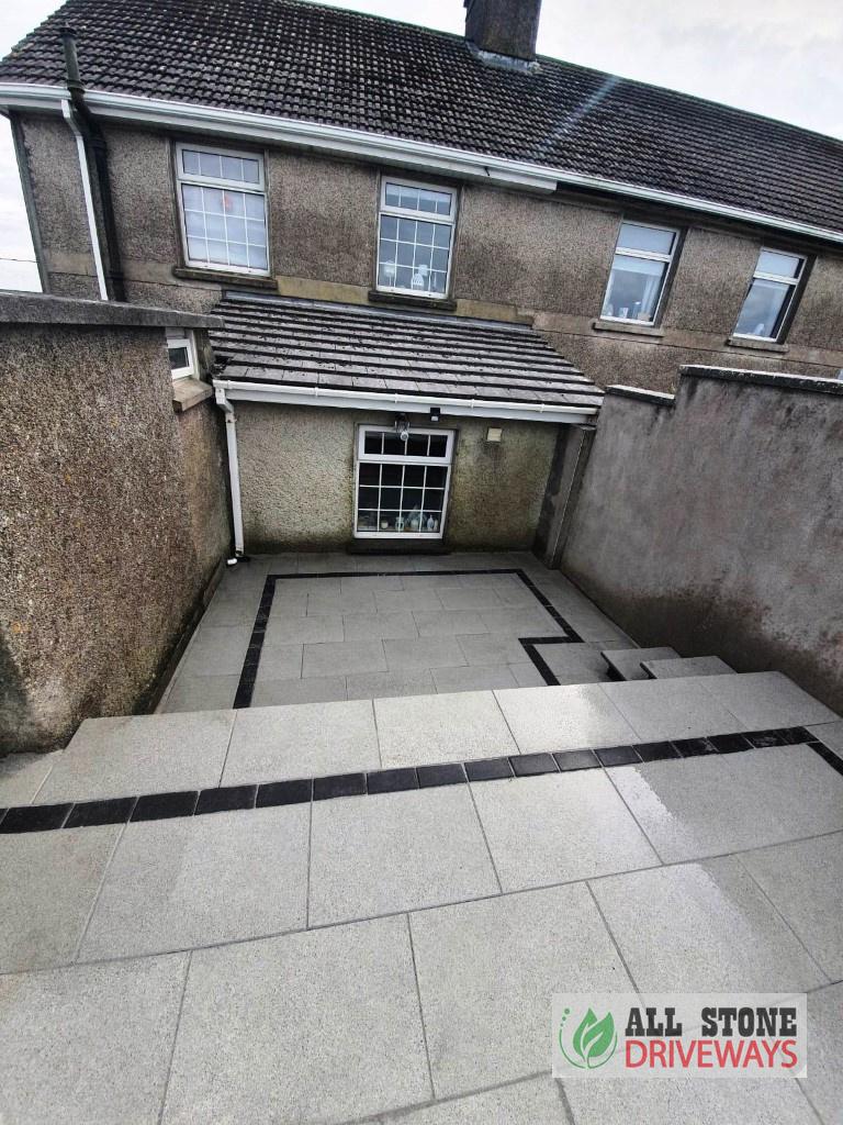 Silver Granite Patio with Brick Border in Crosshaven
