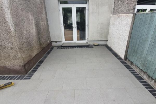 Silver Granite Patio with Slane Brick Border in Douglas, Cork